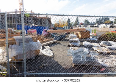 EUGENE, OR - NOVEMBER 4, 2015: Fenced off construction site with ample building materials and supplies.