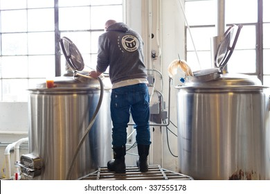EUGENE, OR - NOVEMBER 4, 2015: Head brewmaster Brandon Woodruff commercially brewing an IPA at the startup craft brewery Mancave Brewing.
