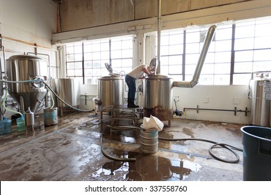 EUGENE, OR - NOVEMBER 4, 2015: Head brewmaster Brandon Woodruff brewing an IPA at the startup craft brewery Mancave Brewing.