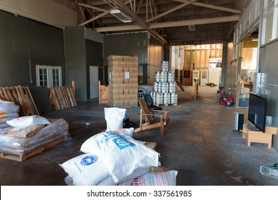 EUGENE, OR - NOVEMBER 4, 2015: Large bottle delivery in boxes at the startup craft brewery Mancave Brewing.
