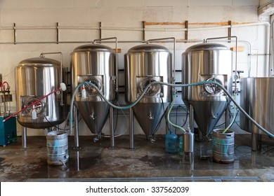 EUGENE, OR - NOVEMBER 4, 2015: Stainless steel commercial beer fermenter at the startup craft brewery Mancave Brewing.