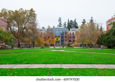 EUGENE, OR - OCTOBER 25, 2016: Students walk across the quad courtyard area at the University of Oregon during a break between classes.