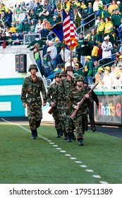 EUGENE, OR - OCTOBER 28, 2006: Army soldiers bring out the flags for a University of Oregon football game versus Portland State at Autzen Stadium.