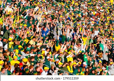 EUGENE, OR - OCTOBER 28, 2006: Autzen Stadium crowd does the wave while cheering on the Oregon Ducks during the UO vs PSU football game.
