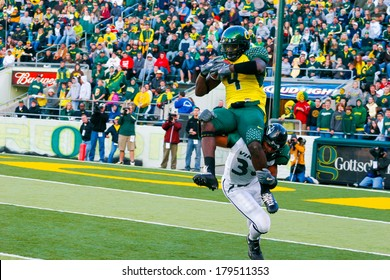 EUGENE, OR - OCTOBER 28, 2006: Oregon ducks receiver Jaison Williams makes a catch before being tackled in the UO vs PSU football game at Autzen Stadium.