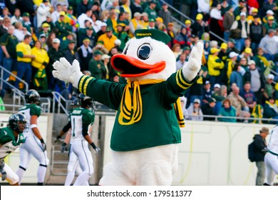 EUGENE, OR - OCTOBER 28, 2006: Oregon duck mascot Puddles holds his arms wide to the crowd at the start of the UO vs PSU football game at Autzen Stadium.