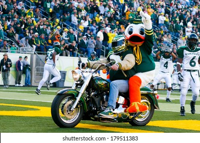 EUGENE, OR - OCTOBER 28, 2006: Oregon duck, Puddles, rides onto the field on the back of a Harley Davidson motorcycle at the UO vs PSU football game at Autzen Stadium.