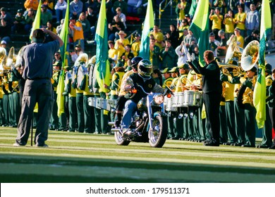 EUGENE, OR - OCTOBER 28, 2006: University of Oregon signature Harley Davidson motorcycle rides out of the tunner before the UO vs PSU game at Autzen Stadium.