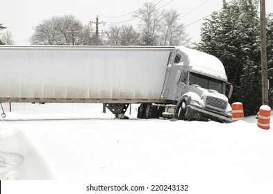 EUGENE, OR, USA -  FEBRUARY, 16, 2014: A semi truck jackknife accident into a ditch during a winter snow and freezing rain storm
