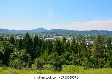 Eugene, Oregon, United States of America – May 29, 2015. View over Eugene, OR, with buildings and vegetation.