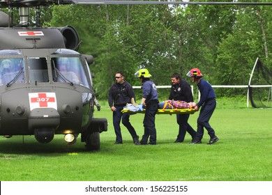 Eugene, Oregon, USA Â?Â? May 2, 2012: Eugene, OR Emergency Services and National Guard work in a disaster drill. Unidentified firemen carried injured person to load on helicopter.