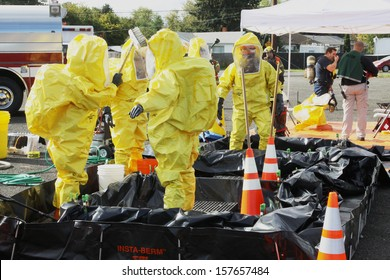 EUGENE, OREGON, USA Â?Â? November 3, 2011: Eugene Fire departments and emergency response teams will conduct disaster preparedness drills. The HAZMAT teams are going through decontamination washes.
