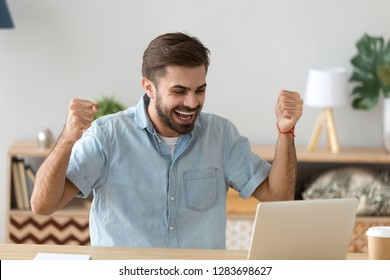 Euphoric young man celebrating success victory excited by online bet bid win at home looking at laptop, happy male winner feel lucky successful got new job opportunity, received good exam test result