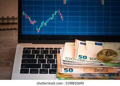 EUR banknote with bitcoin and monitor, Uero banknote over keyboard with forex statistic graph