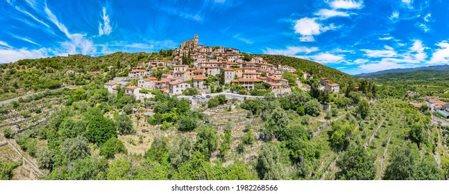 Eur - France - May 25th 2021 - Panoramic aerial drone view of the village of Eus and the Mont Canigou in the background