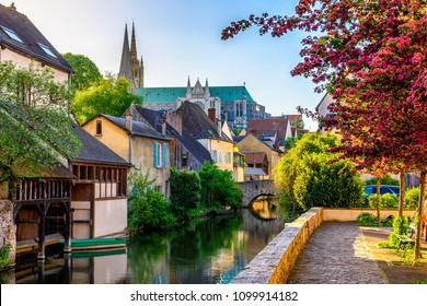 Eure River embankment with old houses and Notre-Dame de Chartres Cathedral in a small town Chartres, France