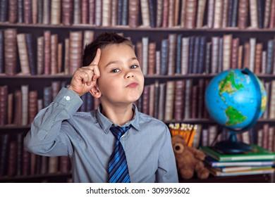 Eureka, first-grader boy thoughtfully rubbing his head