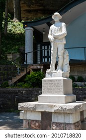 Eureka Springs, AR - June 11, 2021: This marble doughboy statue in Basin Spring Park is in memory of the deceased World War One veterans of the western district of Carroll County.