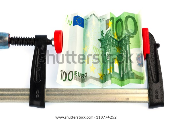 a euro bank note in vise. economic and financial crisis.