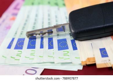 Euro bank notes and car key