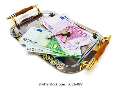 Euro bank notes and keys on a metal tray isolated