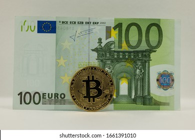 €100 Euro banknote with Bitcoin cryptocurrency trading and exchange