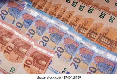 A lot of euro banknotes .10 euros, 20 euros, 50 euros on the table. Money background. Close-up.