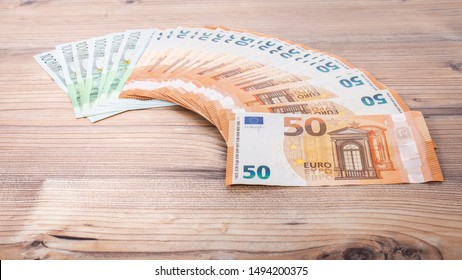 Euro banknotes. 50 euro euro money. Money finance earning sector concept. Cash money on wooden background.  Euro bank notes Laid out in a semicircle.