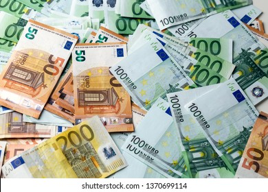 Euro banknotes from above. Scattered banknotes on the table.