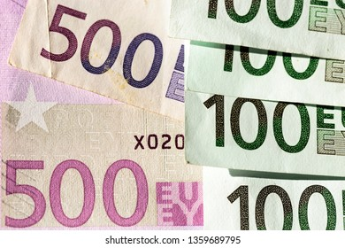 Euro banknotes as a background. Detail of €500 euro banknotes and €100 euro banknotes stacked. European Central Bank.