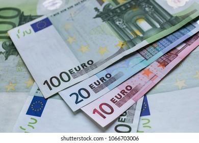 Euro banknotes as a background. Euro money cash. One Hundred, Twenty, Ten. Business, savings