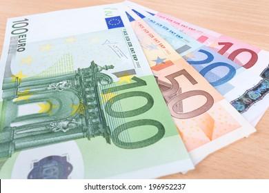 Euro banknotes closeup on table