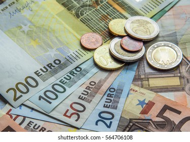 Euro banknotes and coin for background. The euro money currency