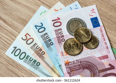 euro banknotes coin wood table