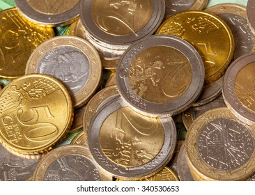 Euro banknotes and coins background - macro shot