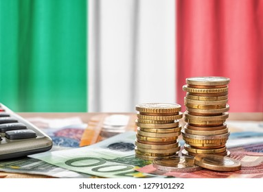 Euro banknotes and coins in front of the national flag of Italy