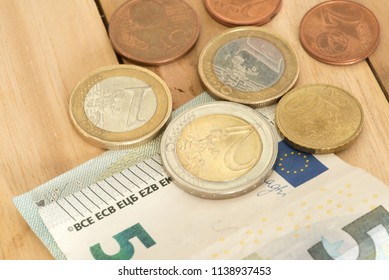 Euro banknotes and coins and minimum wage 9,14 EUR in Germany