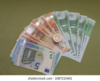 Euro banknotes and coins money (EUR), currency of European Union