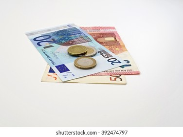 Euro banknotes with coins on white background