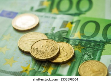 Euro banknotes and coins. Personal finance concept