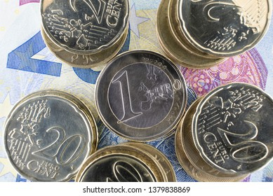 Euro banknotes and coins. Personal finance concept. Macro photo.
