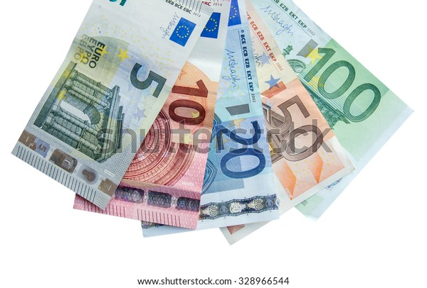 euro banknotes with different denomination and coins, isolated