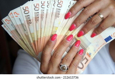 Euro banknotes in female hand
