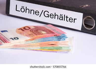Euro banknotes and a folder with German words for wages and salaries