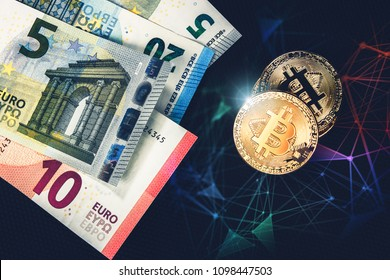 Euro banknotes and gold bitcoins closeup. Virtual crypto currency and finances concept