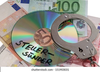 Euro banknotes with handcuffs and CD with the german words tax evader / tax evader
