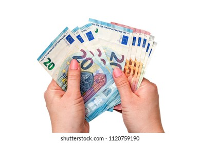 Euro banknotes in hands on a white background