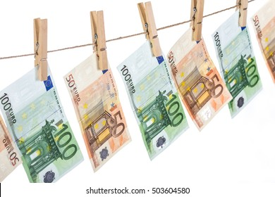 Euro banknotes hanging on clothesline on white background. Money laundering concept. Closeup