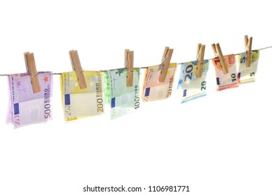 Euro banknotes hanging a rope with clothes pins. Money background. Selective focus