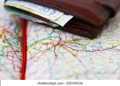 Euro banknotes inside wallet on a geographical map of Budapest, Hungary